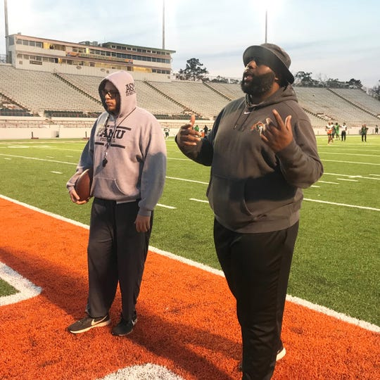 FAMU graduate assistant Mateo Kambui stands alongside offensive line coach Alex Jackson during practice. Kambui is coaching the Orange team for the spring game.