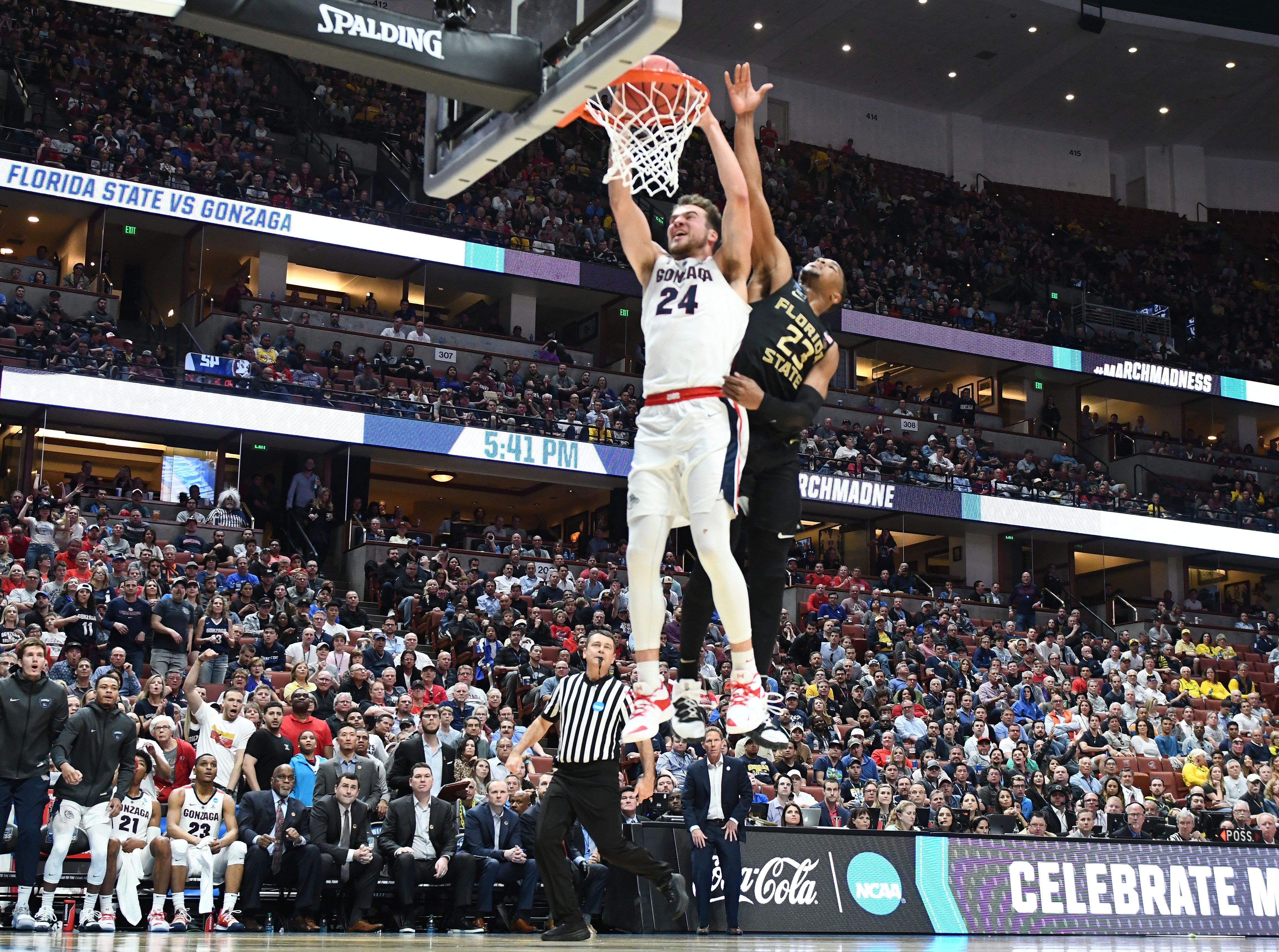 March 28, 2019; Anaheim, CA, USA; Gonzaga Bulldogs forward Corey Kispert (24) scores a basket ahead of Florida State Seminoles guard M.J. Walker (23) during the second half in the semifinals of the west regional of the 2019 NCAA Tournament at Honda Center. Mandatory Credit: Robert Hanashiro-USA TODAY Sports