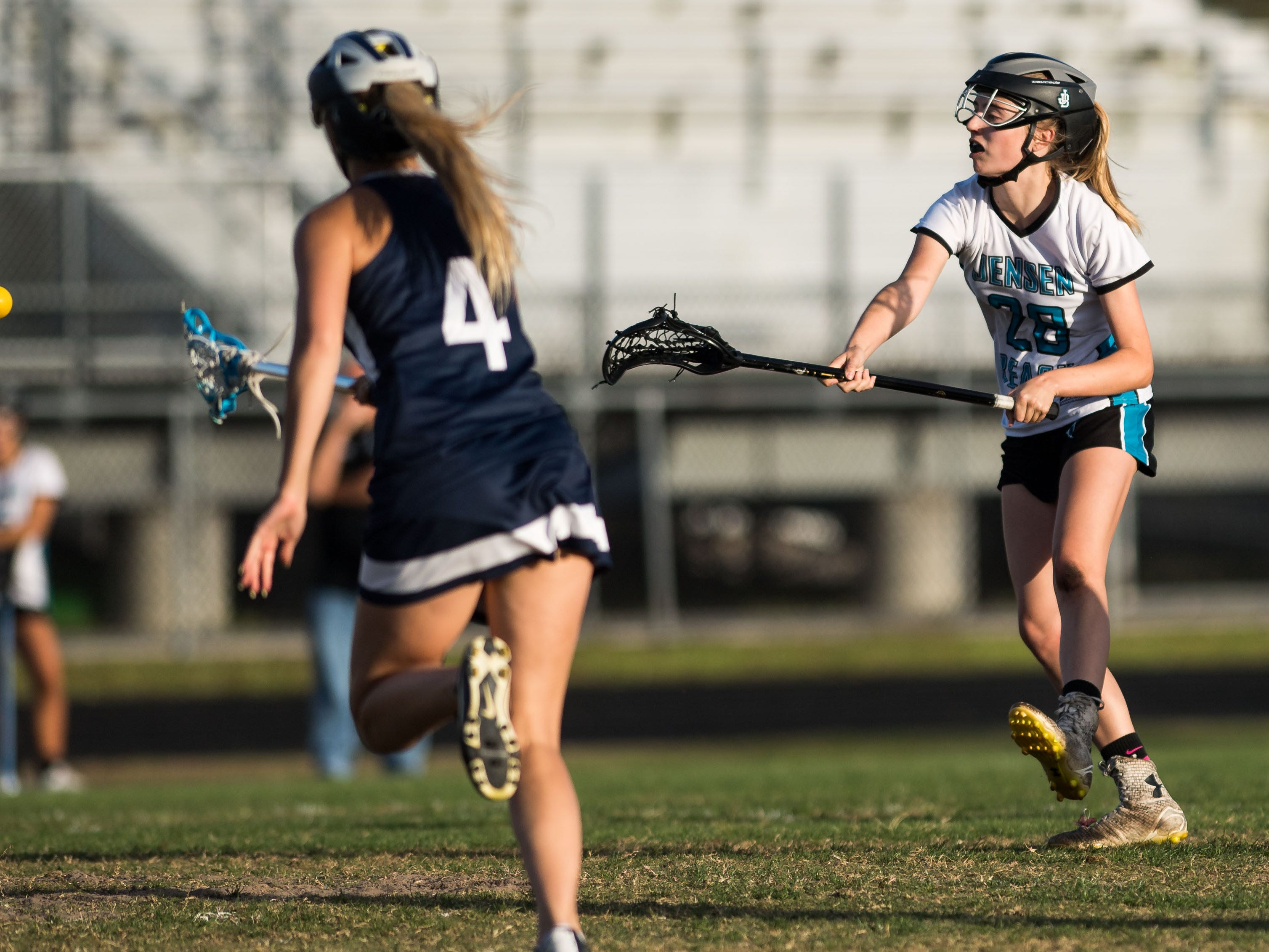 Jensen Beach's Kati Willis scores on a free-position shot in the first half against St. Edward's at the high school girls lacrosse game Thursday, March 28, 2019, at Jensen Beach High School.