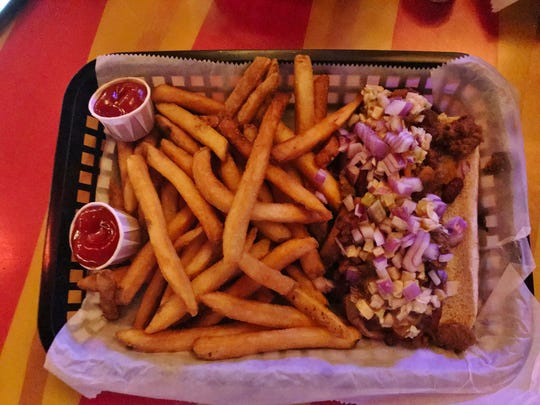 The Square Grouper hot dog was 100% beef topped with chili, onions, slaw, and melted cheese.