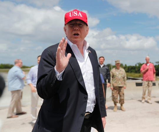 President Donald Trump speaks to reporters during a visit March 29, 2019, to the southeast shore of Lake Okeechobee.