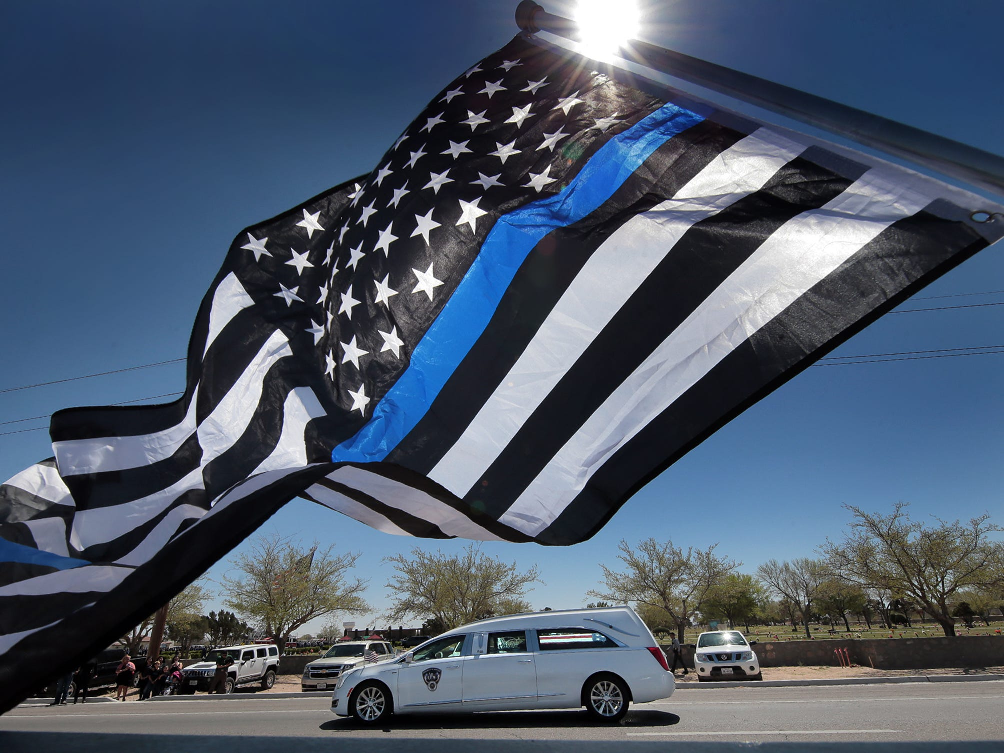 The hearse carrying El Paso County Sheriff's Deputy Peter Herrera's casket arrives at Evergreen Cemetery East for the slain deputy's graveside service Friday, March 29, 2019. Herrera, 35, died at a hospital Sunday, two days after being shot during a traffic stop in San Elizario, Texas. The suspect in the deputy's killing, Facundo Chavez, remains jailed ona capital murder charge.