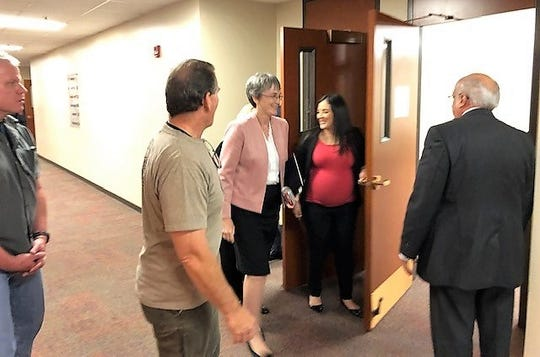 Heather Wilson, in pink jacket, heads to another of a series of short meetings with UTEP students, faculty , staff, and college deans March 28 as she aims to secure the UTEP presidency, for which she is the sole finalist.