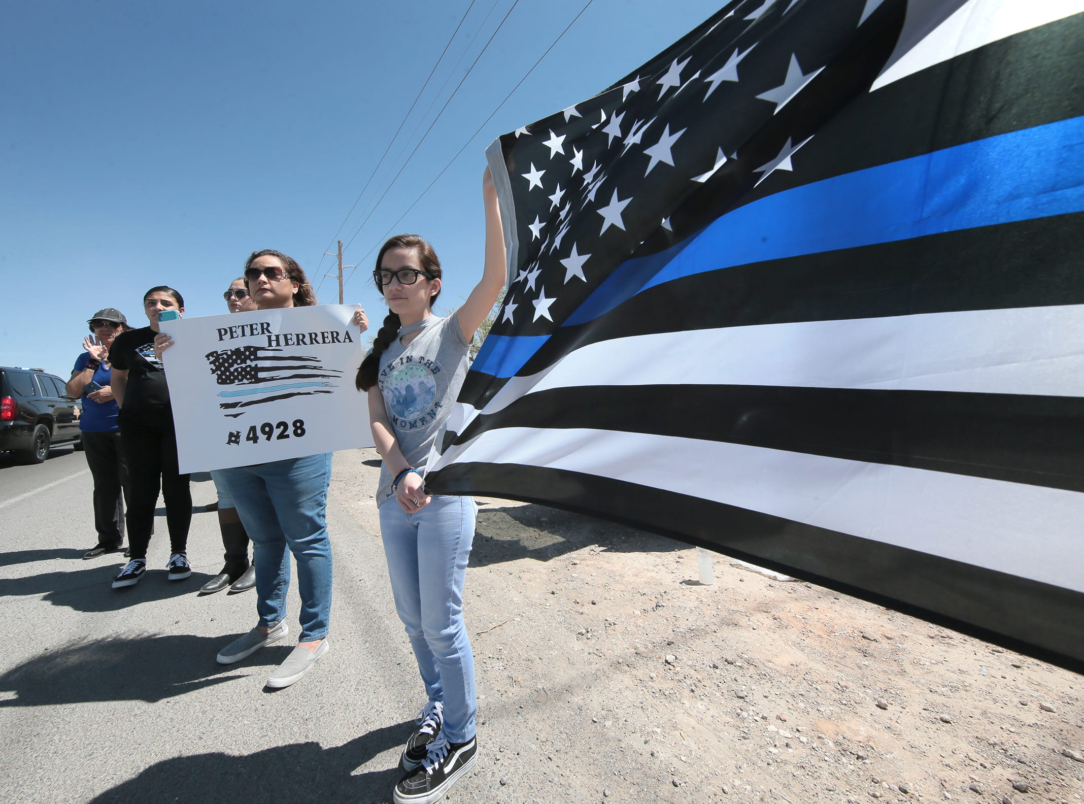 Mourners line the funeral procession route Friday, March 29, 2019, for El Paso County Sheriff's Office Deputy Peter Herrera, who was fatally shot in a traffic stop.