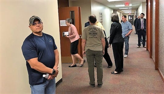 UTEP president finalist Heather Wilson dashes into another of a series of meetings with UTEP groups March 28 as a UTEP police officers in plainclothes keep guard.