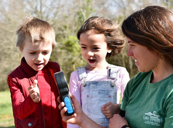 Taylor Phillips, right, an educator at Lake Conestee Nature Park, uses an anemometer to show children how to measure windspeed during the Knee High Naturalist program at the park on Friday morning, March 29, 2019. The Knee-High Naturalist program offers two 1.5 hour classes per month to pre-kindergarten students. There is a 6 class series offered each season except for winter.