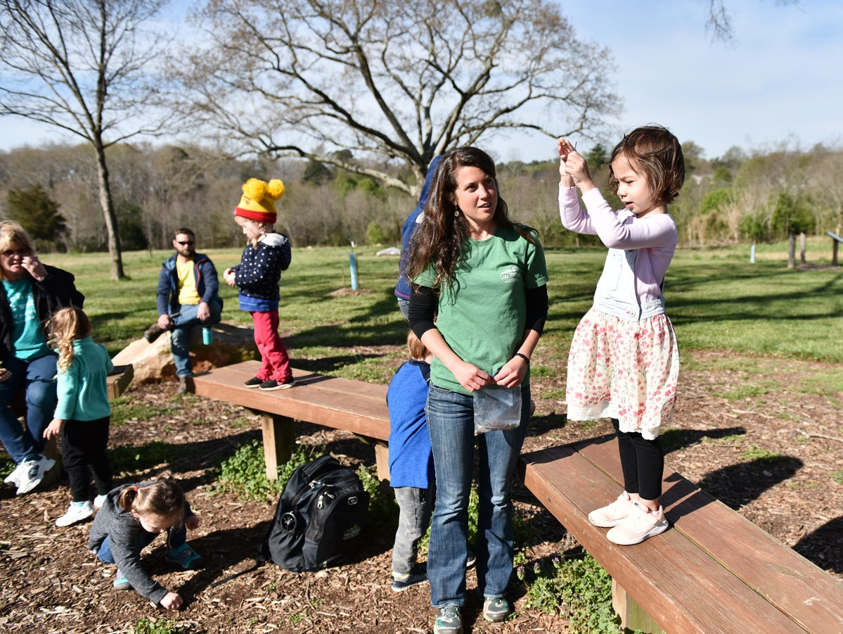 Children participating in the Knee High Naturalists program drop items of different weights and sizes while learning about wind resistance at Lake Conestee Nature Park on Friday morning, March 29, 2019.