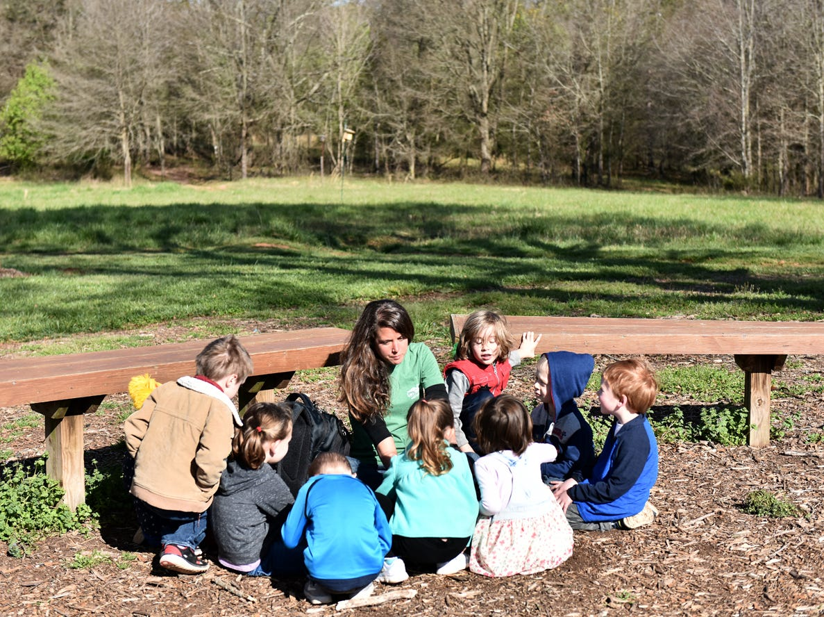 Taylor Phillips, middle, an educator at Lake Conestee Nature Park, talks with children in the Knee High Naturalists program at the park on Friday morning, March 29, 2019.