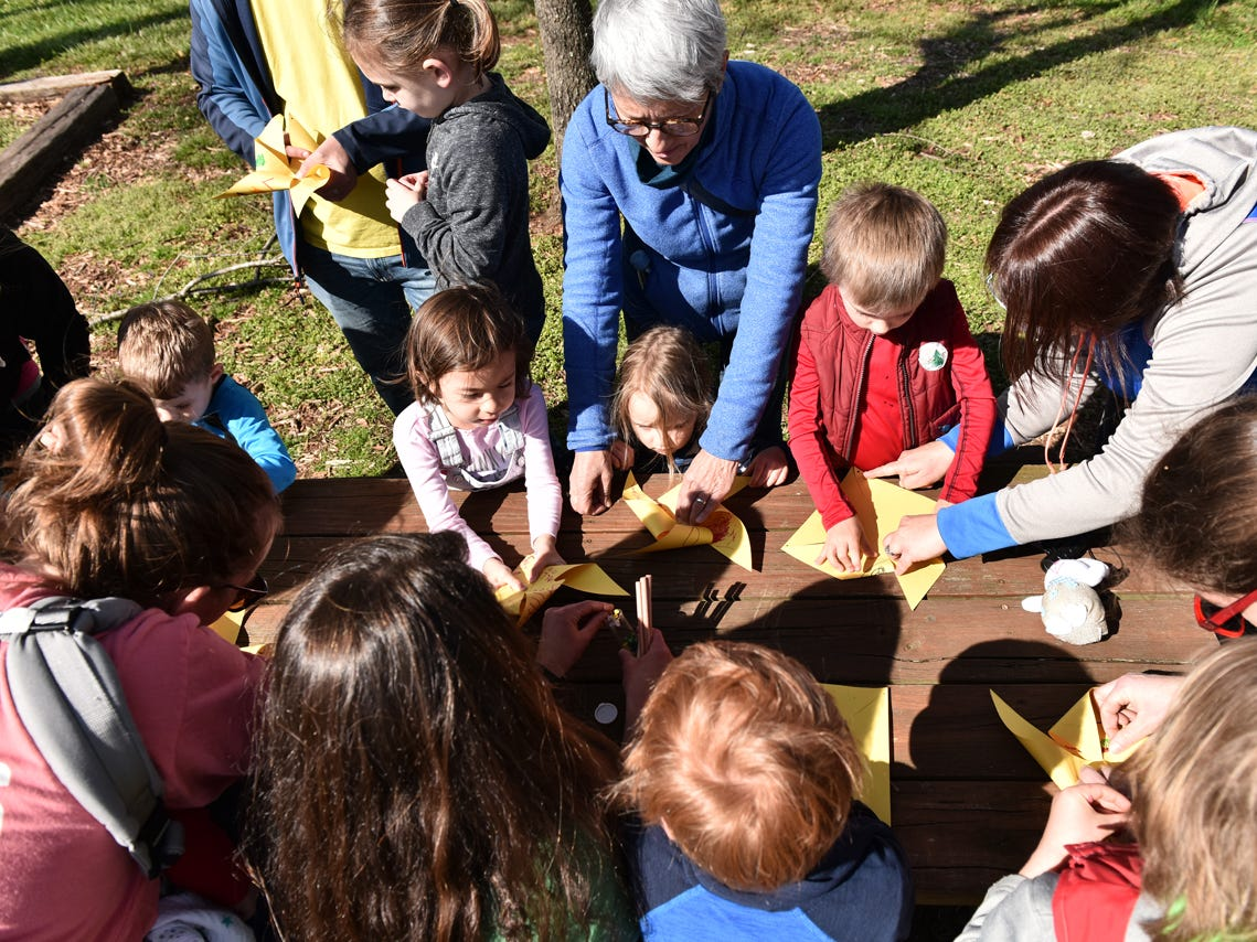 Children participating in the Knee High Naturalists program build pinwheels at Lake Conestee Nature Park on Friday morning, March 29, 2019.