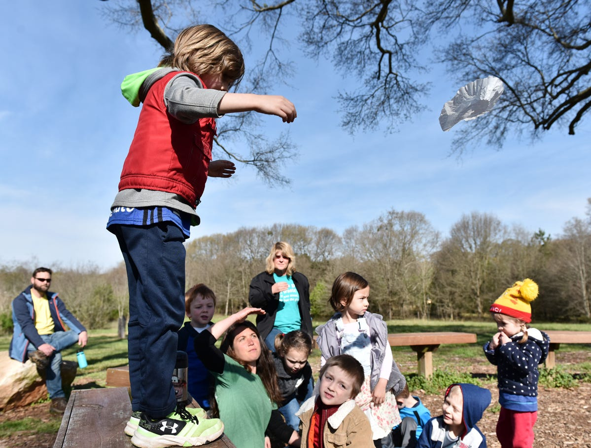 Children participating in the Knee High Naturalists program drop coffee filters while learning about wind resistance at Lake Conestee Nature Park on Friday morning, March 29, 2019.
