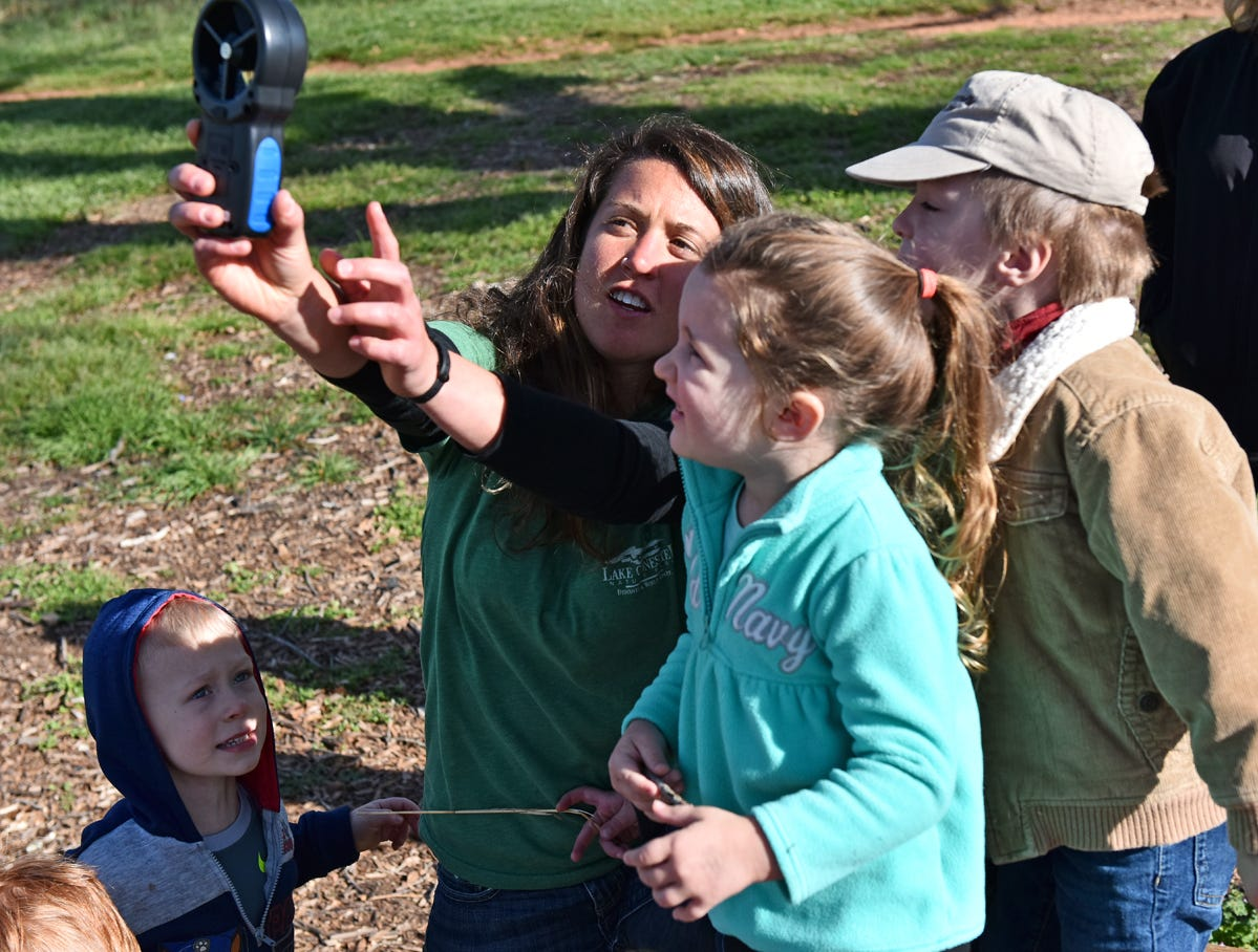 Taylor Phillips, an educator at Lake Conestee Nature Park, right, uses an anemometer to show children how to measure windspeed during the Knee High Naturalist program at the park on Friday morning, March 29, 2019.