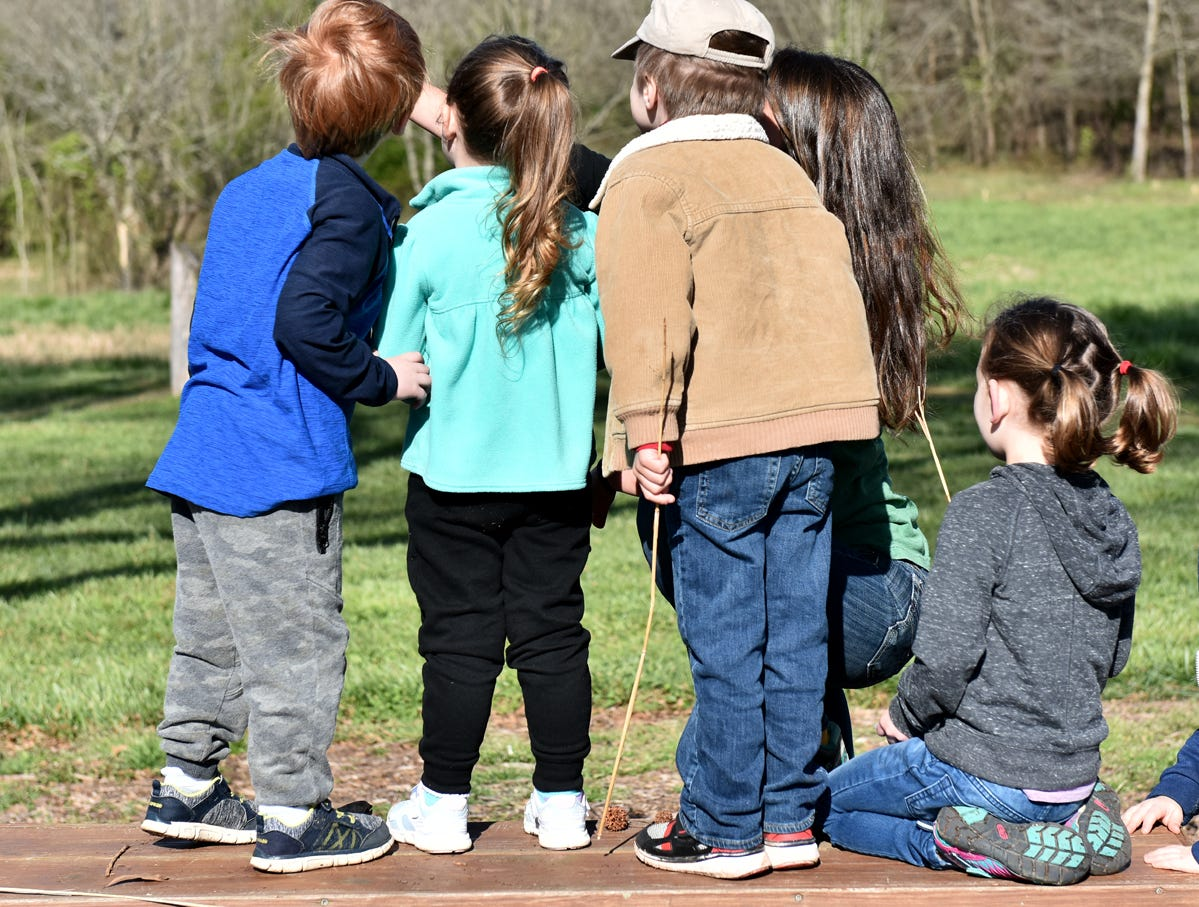 Children gather around Taylor Phillips, an educator at Lake Conestee Nature Park, as she uses an anemometer to measure wind speed during the Knee High Naturalists program at Lake Conestee Nature Park on Friday morning, March 29, 2019.
