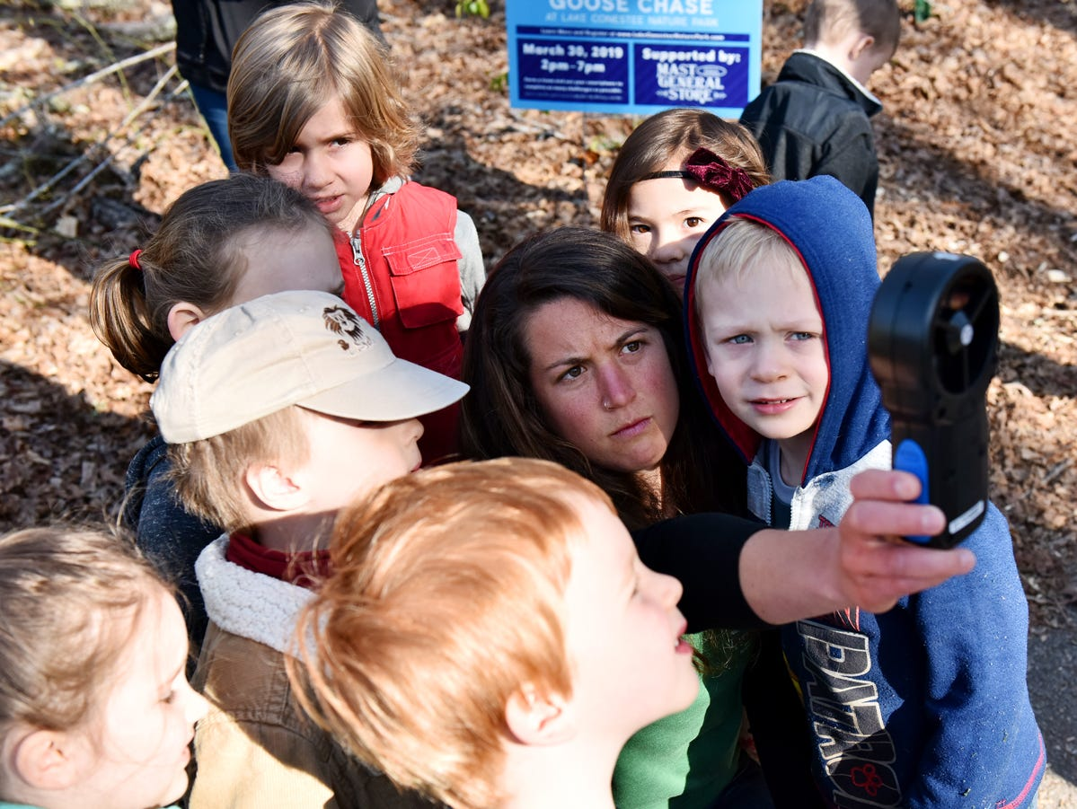 Taylor Phillips, an educator at Lake Conestee Nature Park, middle, uses an anemometer to show children how to measure windspeed during the Knee High Naturalist program at the park on Friday morning, March 29, 2019. The Knee-High Naturalist program offers two 1.5 hour classes per month to pre-kindergarten students. There is a 6 class series offered each season except for winter.
