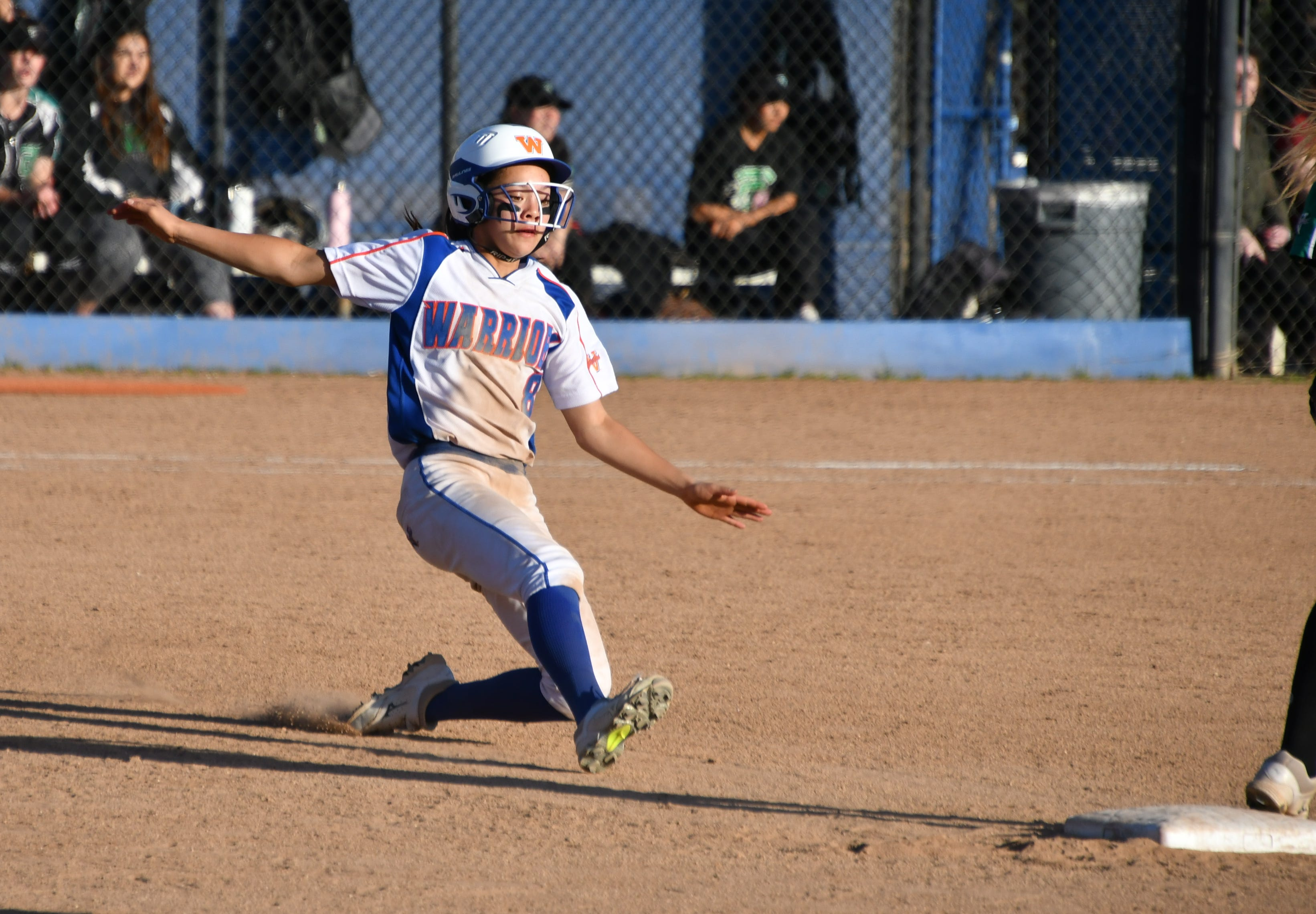 Westlake High freshman Emily Jones slides into second base against visiting Thousand Oaks on Thursday afternoon. Thousand Oaks won, 10-4, in 10 innings.