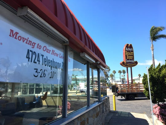 A window banner alerts would-be diners that the Ventura Arby's has moved to its new location at 4724 Telephone Road. The original, 1960s-era building and sign at 3550 E. Main St. are slated for demolition to make way for a Starbucks drive-thru.