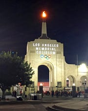This Nov. 4, 2017, photo shows the peristyle of the Los Angeles Memorial Coliseum with the Olympic flame lit during a USC football game in Los Angeles. United Airlines offered to withdraw from a $69 million deal to change Los Angeles Memorial Coliseum into United Airlines Memorial Coliseum following criticism that adding a corporate name is disrespectful to the facility's history of honoring troops who fought and died in World War I.