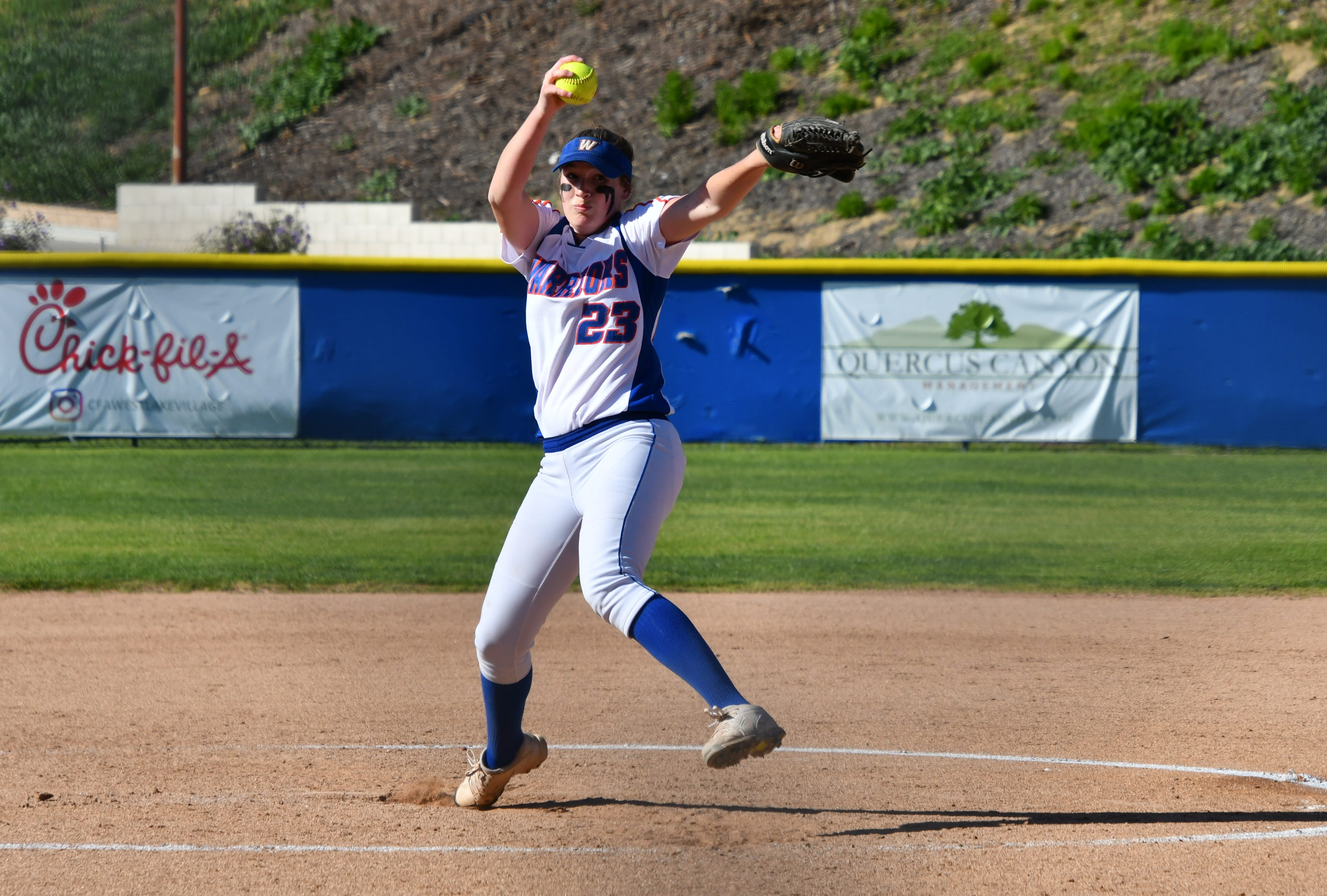 Westlake senior Alexa Campbell delivers a pitch against visiting Thousand Oaks on Thursday afternoon. Thousand Oaks won, 10-4, in 10 innings.