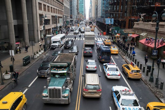 FILE - In this Thursday, Jan. 11, 2018 file photo, traffic makes it's way across 42nd Street near Grand Central Terminal in New York. New York Gov. Andrew Cuomo and New York City Mayor Bill de Blasio on Tuesday Feb. 26, 2019, announced a deal on plans for new tolls on motorists entering the heart of Manhattan, an important show of support as state lawmakers debate ways to raise revenue for an outdated transit system.(AP Photo/Mary Altaffer, File)