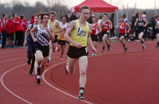 North Salem's Ben Leicht on his way to winning the boys mile during the Somers Tusker Twilight Relays at Somers High School  March 28, 2019.