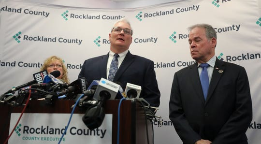 County Attorney Thomas Humbach, center with County Executive Ed Day and Commissioner of Health Dr. Patricia Schnabel Ruppert gives an update regarding the effects of the State of Emergency Declaration in New City on Friday, March 29, 2019.
