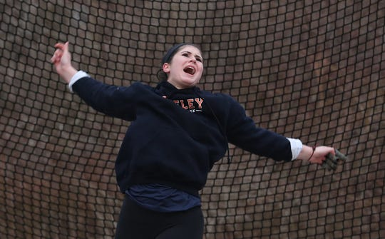 Horace Greeley's Kira Lindner on her way to winning the girls hammer throw during the Somers Tusker Twilight Relays at Somers High School  March 28, 2019.