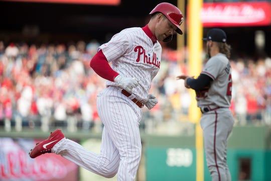 Phillies' Rhys Hoskins (4) runs past third base after hitting a grand slam Thursday at Citizens Bank Park.