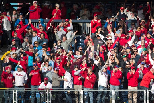 Fans cheer after first basemen Rhys Hoskins hit a grand slam in the 7th inning Thursday at Citizens Bank Park.