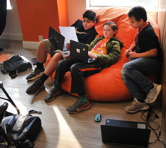 Fain Elementary School students Mateo Deloyos, Jacob Lawrence, and Shawn Chandler learn to about entrepreneurship during a hackathon learning session held at Dexter Learning Center Friday morning.