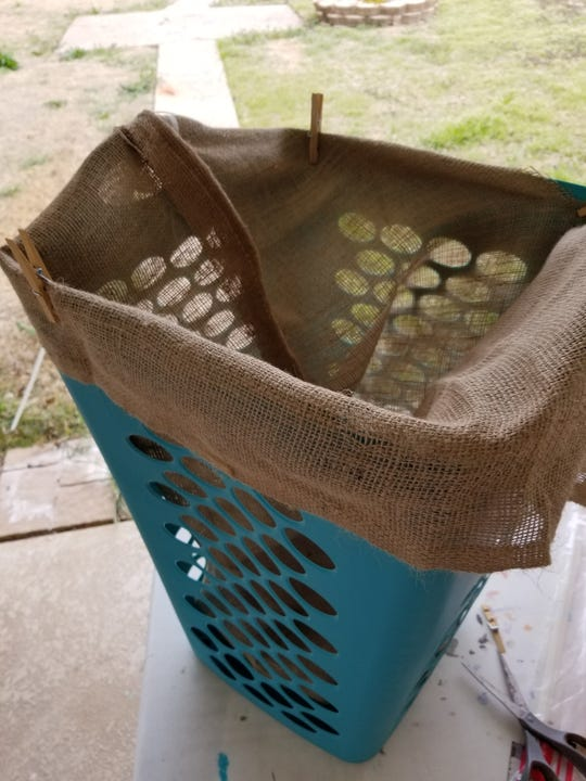 For a strawberry planter: After drilling holes in bottom for drainage, line your hamper with a burlap bag, making sure that the bag is just lining the bottom of the hamper without excess fabric.
