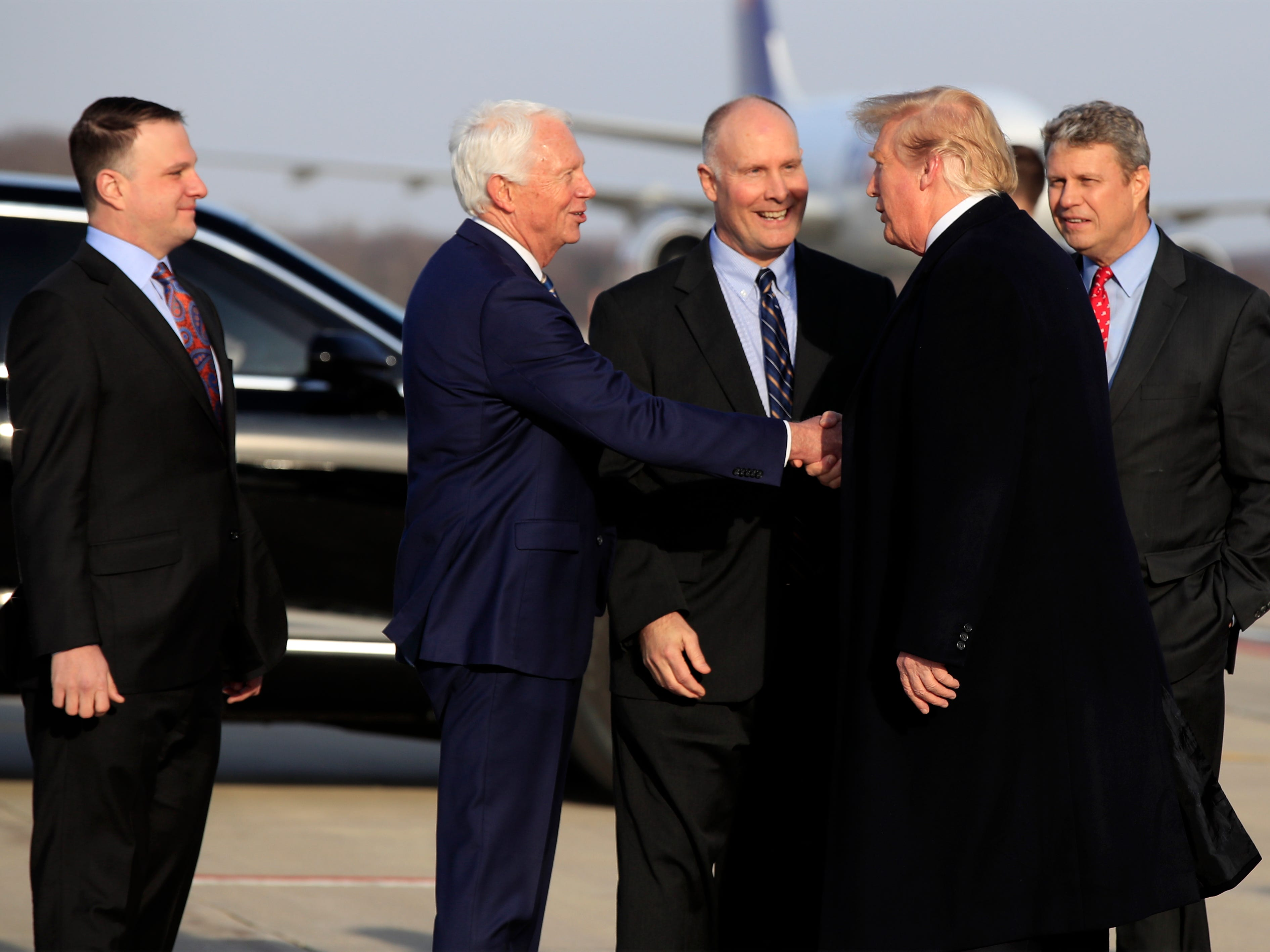 President Trump arrives at Gerald R. Ford International Airport in Grand Rapids, Mich., to attend a campaign rally.