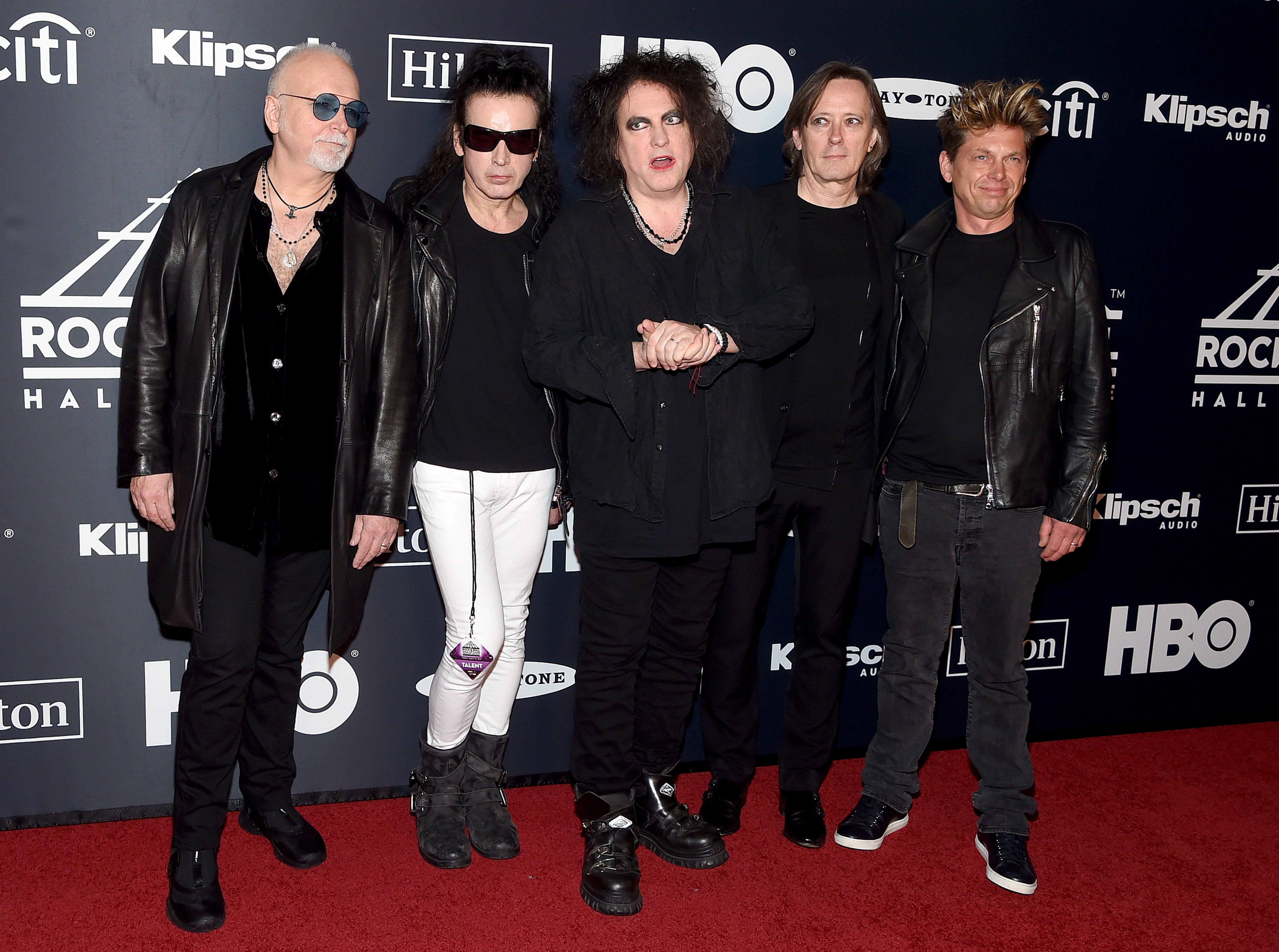 NEW YORK, NEW YORK - MARCH 29: Inductees Reeves Gabrels, Simon Gallup, Robert Smith, and Jason Cooper of The Cure attend the 2019 Rock & Roll Hall Of Fame Induction Ceremony at Barclays Center on March 29, 2019 in New York City. (Photo by Jamie McCarthy/WireImage) ORG XMIT: 775320639 ORIG FILE ID: 1139166092
