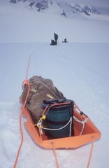 A Clean Mountain Can on the back of a sled on Alaska's Denali. CMCs are used to securely hold human solid waste so it can be packed off the mountain.