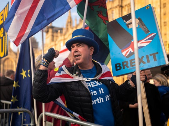 A 'Stop Brexit' campaigner protests outside of the Houses of Parliament in London, on March 28, 2019.