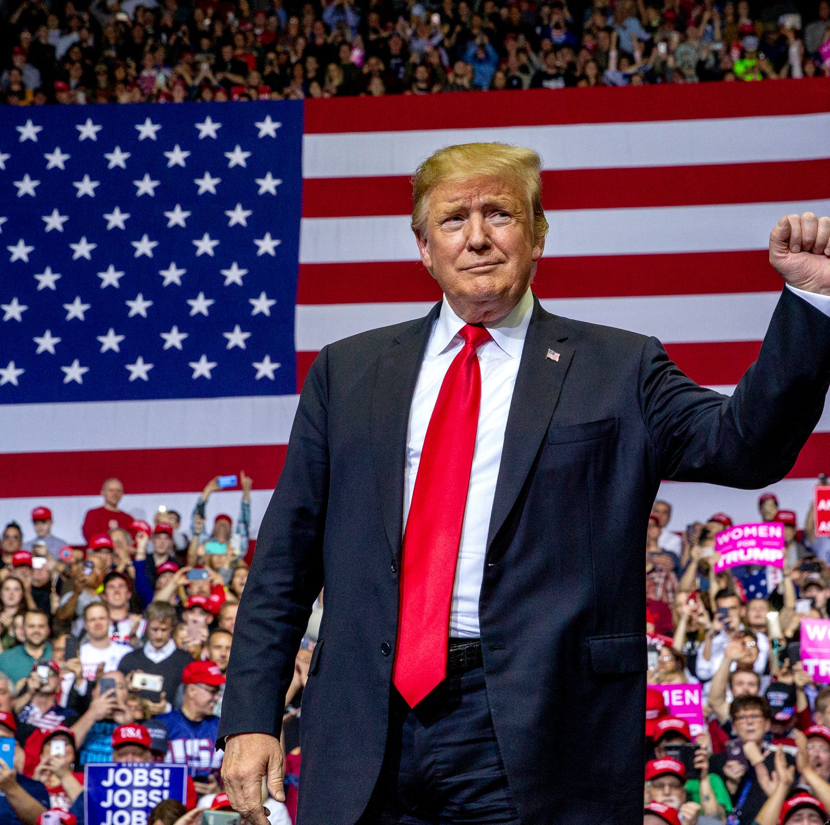 President Donald Trump gestures at a campaign rally at Van Andel Arena in Grand Rapids, Michigan, on Thursday, March 28, 2019.