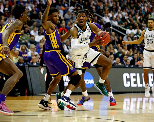 Michigan State forward Aaron Henry drives to the basket against LSU guard Marlon Taylor during the Sweet 16 of the 2019 NCAA tournament.