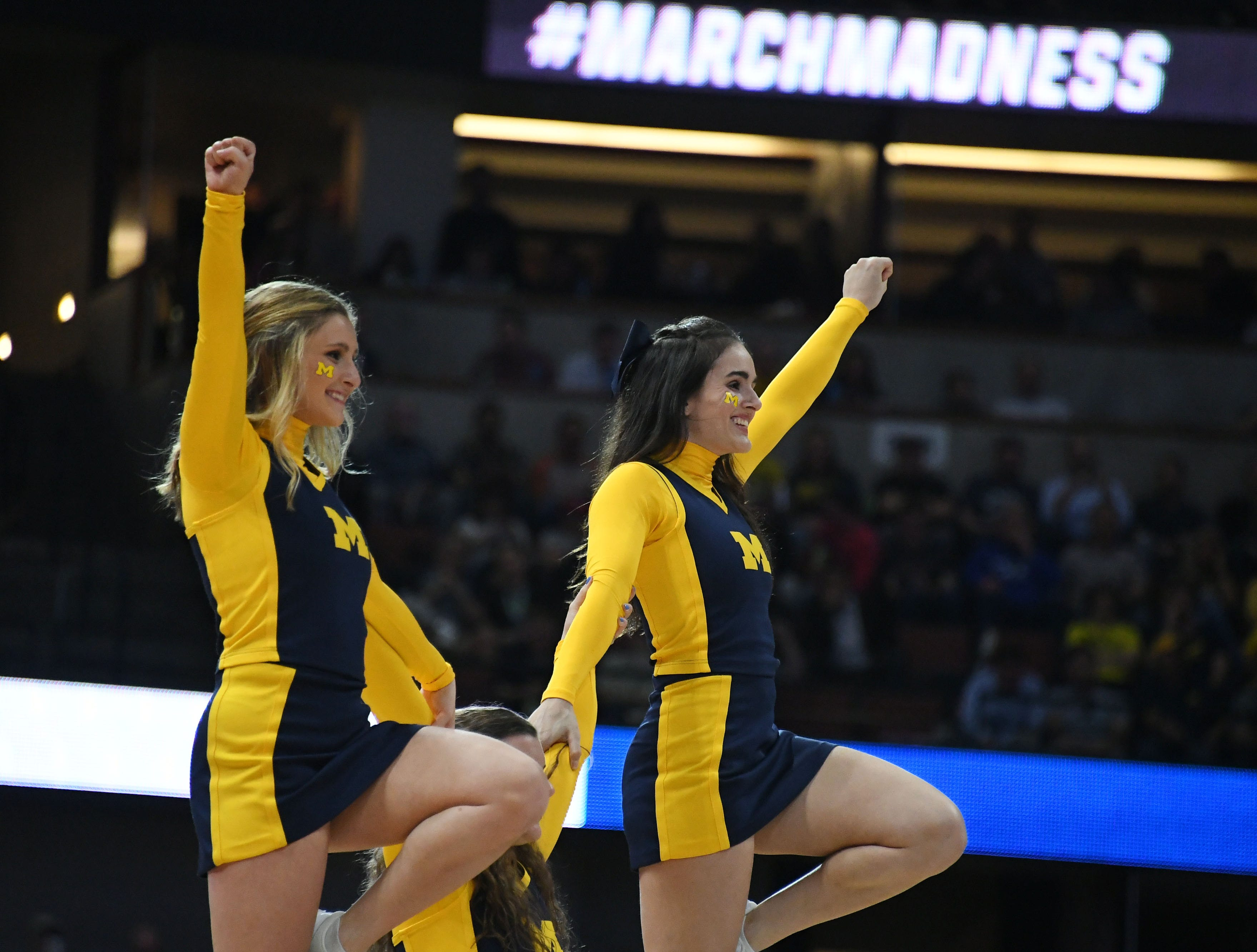 Sweet 16: Michigan Wolverines cheerleaders perform during a game against the Texas Tech Raiders.