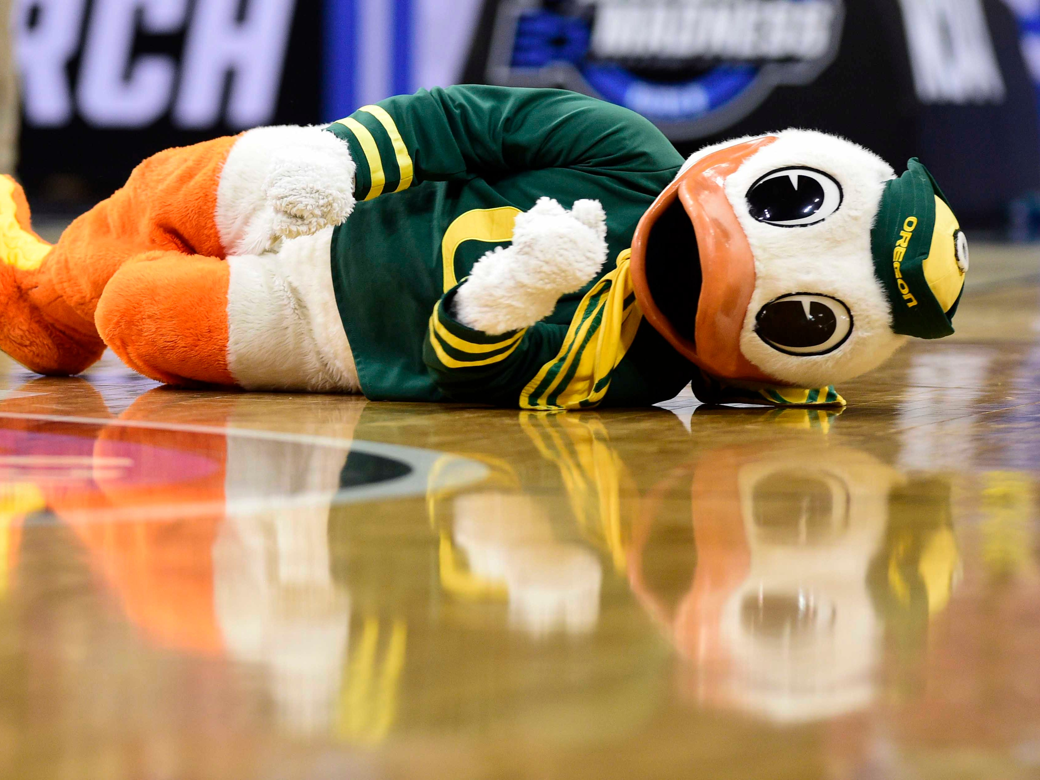 Sweet 16: The Oregon Ducks mascot performs during a game against the Virginia Cavaliers.