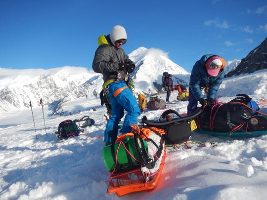 Former National Park Service ranger Dan Corn prepares to depart Kahiltna Basecamp is at 7,200 feet on Alaska's Denali with his Clean Mountain Can strapped to his sled. The CMC (green, with straps) is used to store solid human waste during the trek up and down the mountain.
