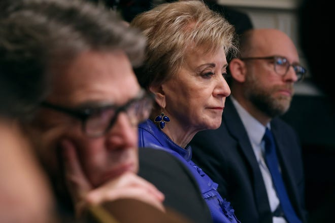 Small Business Administrator Linda McMahon listens to U.S. President Donald Trump talk to reporters during a cabinet meeting in February.