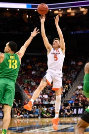 Virginia Cavaliers guard Kyle Guy (5) shoots as Oregon Ducks forward Paul White (13) defends during the first half in the semifinals of the south regional of the 2019 NCAA Tournament at KFC Yum Center. (Photo: Jamie Rhodes, USA TODAY Sports)