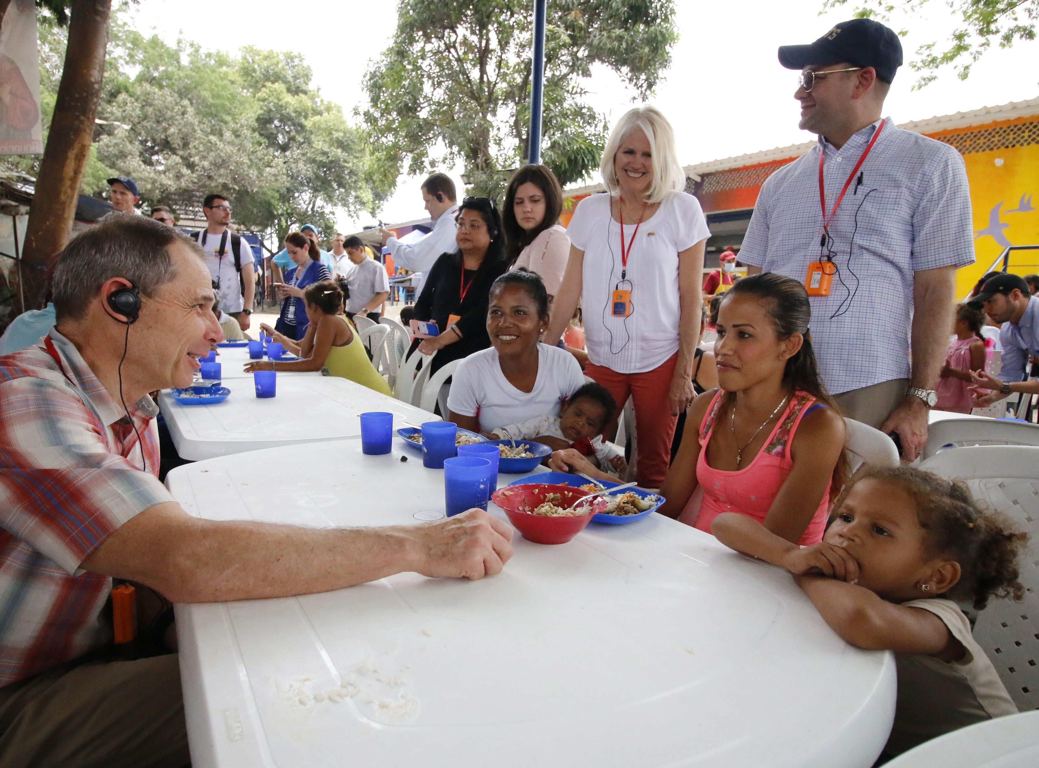 US Senator John Curtis, left, converses with a Venezuelan family during a visit of several US senators to the Simon Bolivar international bridge, on the border between Venezuela and Cucuta, Colombia on March 29, 2019.