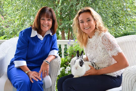 Second lady Karen Pence, left, and Charlotte Pence pose with vice presidential pet bunny Marlon Bundo.