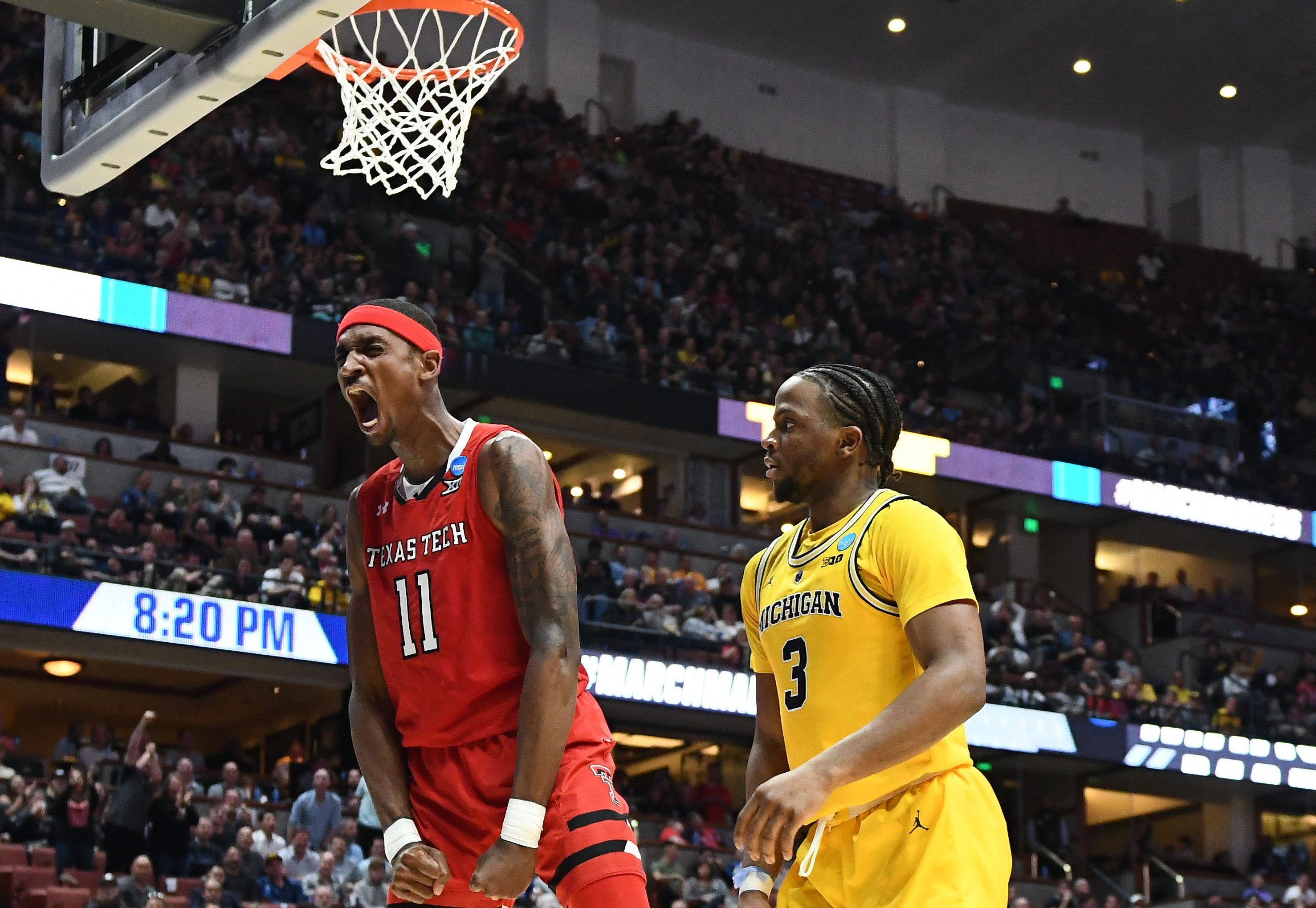 Sweet 16: Texas Tech Red Raiders forward Tariq Owens shouts after he scores a basket against the Michigan Wolverine.