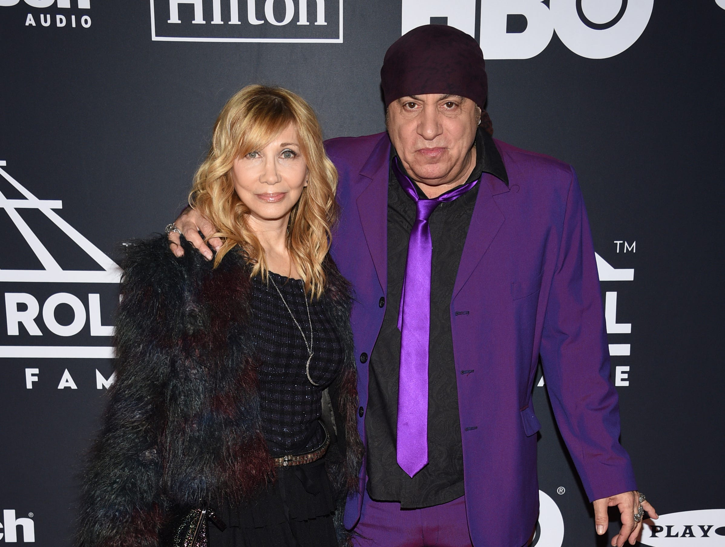 Steven Van Zandt, right, and Maureen Van Zandt arrive at the Rock & Roll Hall of Fame induction ceremony at the Barclays Center on Friday, March 29, 2019, in New York. (Photo by Evan Agostini/Invision/AP) ORG XMIT: NYPM117