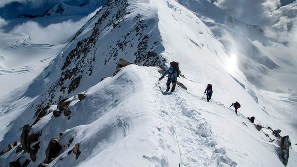 A group of climbers led by RMI Expeditions guides...
