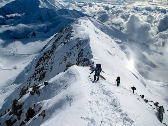 A group led by RMI Expeditions guides climbs Denali, the tallest peak in North America, in Alaska.