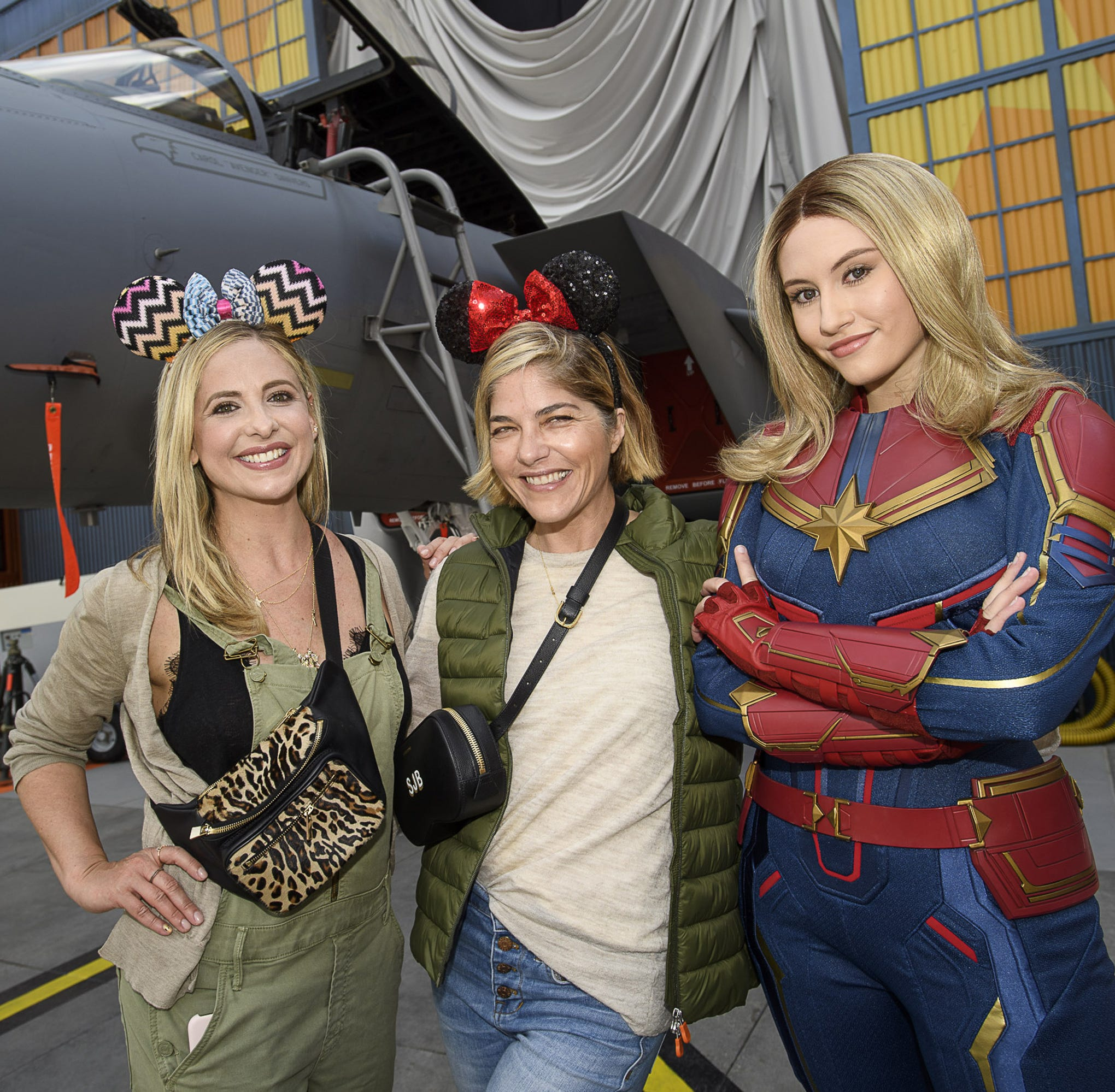 ANAHEIM, CA  MARCH 28:  In this handout photo provided by Disneyland Resort, actresses and friends Sarah Michelle Gellar (left) and Selma Blair share a special moment with Captain Marvel at Disney California Adventure Park on March 28, 2019 in Anaheim, California. The friends were celebrating over 20 years of friendship while visiting Disneyland Resort. (Photo by Richard Harbaugh/Disneyland Resort via Getty Images) ORG XMIT: 775306367 ORIG FILE ID: 1133282941