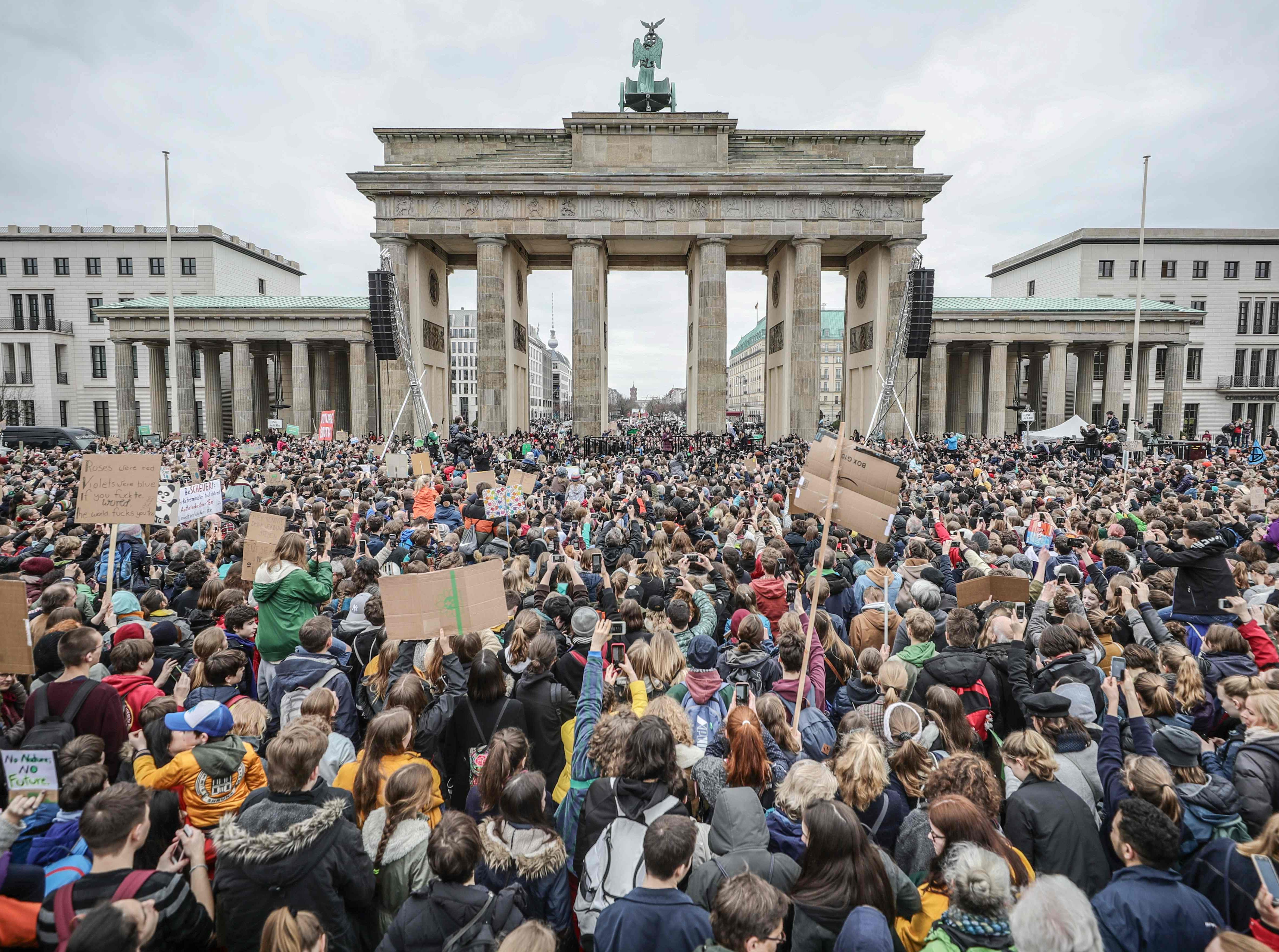 """Swedish climate activist Greta Thunberg addresses the """"Fridays for Future"""" demonstration for a better climate policy in front of Berlin's landmark Brandenburg Gate on March 29, 2019."""