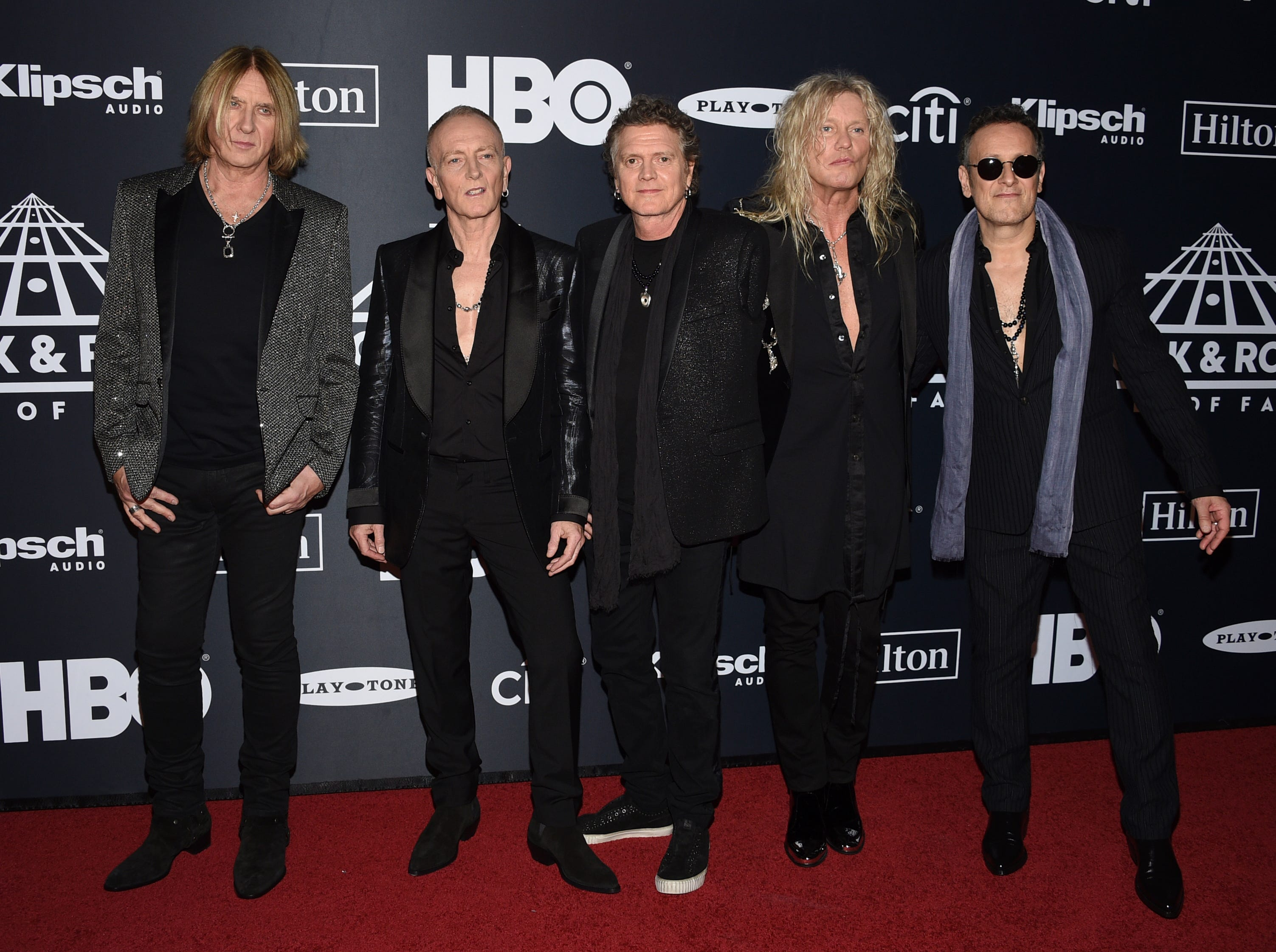 Joe Elliott, from left, Phil Collen, Rick Allen, Rick Savage and Vivian Campbell, of Def Leppard, arrive at the Rock & Roll Hall of Fame induction ceremony at the Barclays Center on Friday, March 29, 2019, in New York. (Photo by Evan Agostini/Invision/AP) ORG XMIT: NYPM116