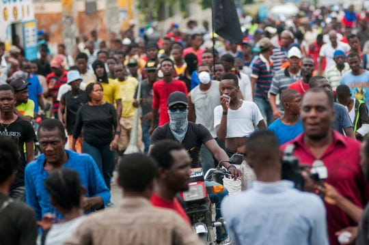 Demonstrators participate in a march against the Government in Port-au-Prince, Haiti on March 29,  2019.